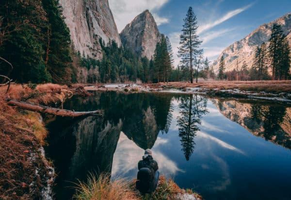 hiker in Yosemite taking a break by the water