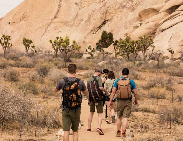 group of people hiking in Joshua Tree