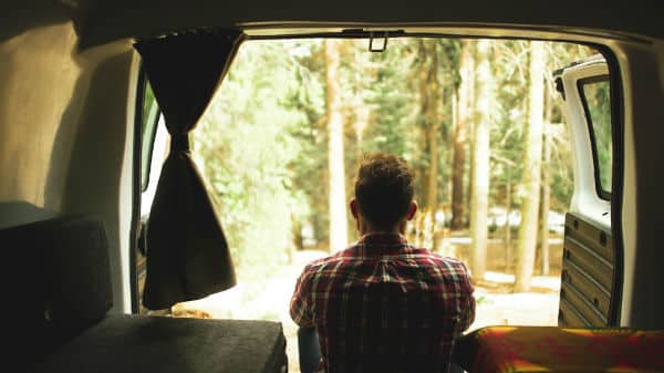 Man waking up in a campervan