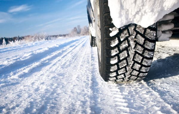 snow tires on a snow packed road