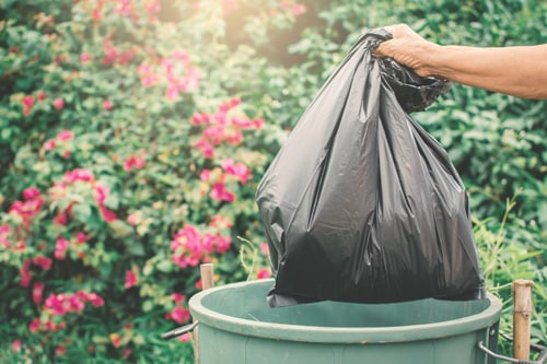 garbage bags being placed in the bin