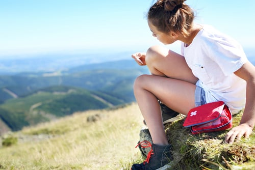 woman hiking with first aid kit