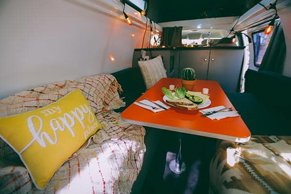 Inside a campervan with breakfast