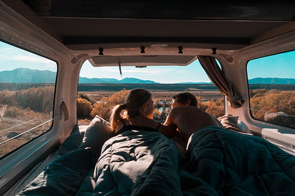 Couple in the back of a campervan