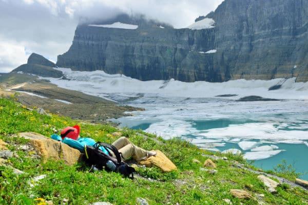 Hiker resting at Grinnell Glacier in GNP