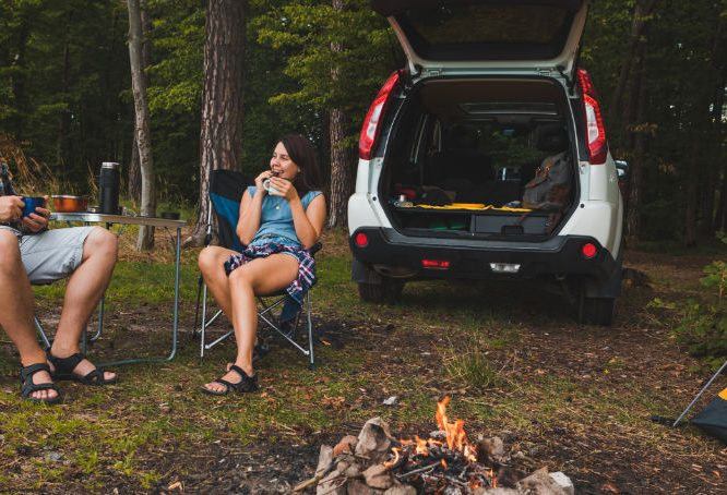Man and woman dispersed camping
