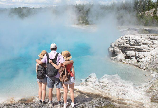 Family hiking near geyser basins in Yellowstone
