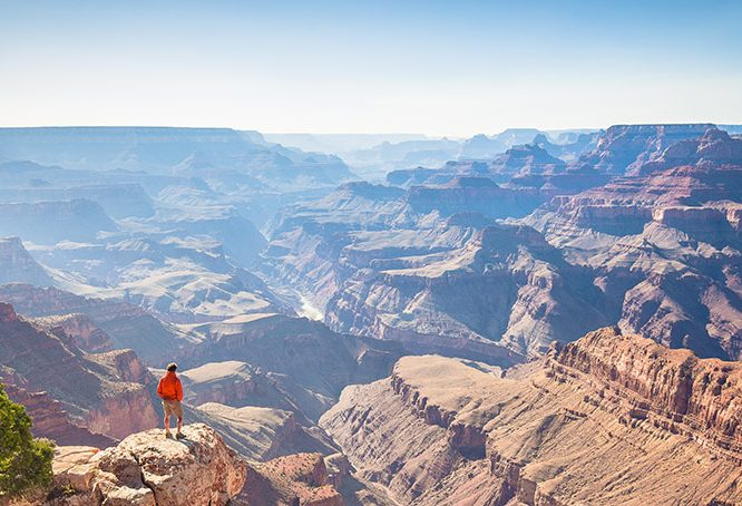 Hiker in Grand Canyon National Park - Best hiking destinations for a campervan road trip in the united states