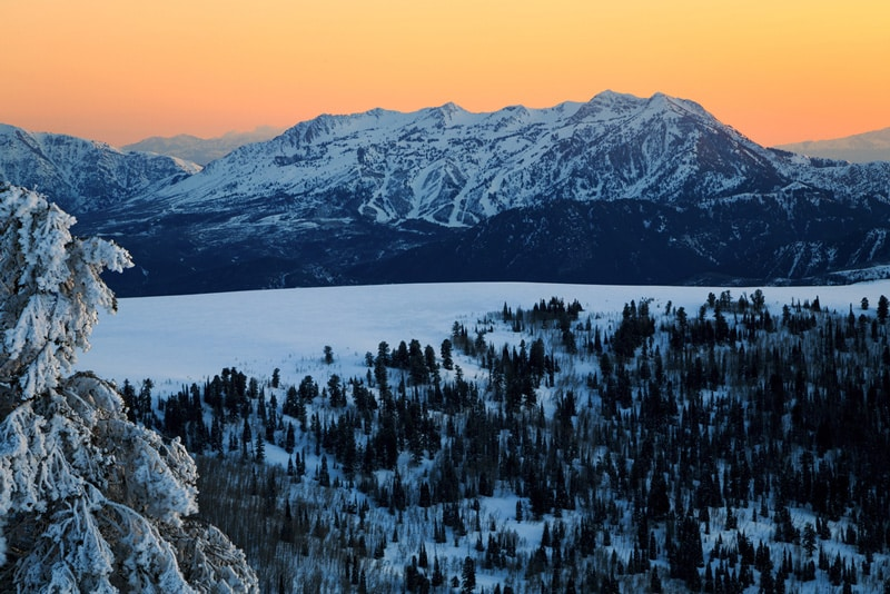 Sunset over snowy mountains at Snow Basin, Utah