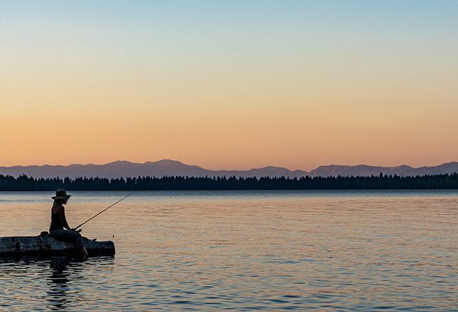 Woman fishing at Lake Tahoe, California