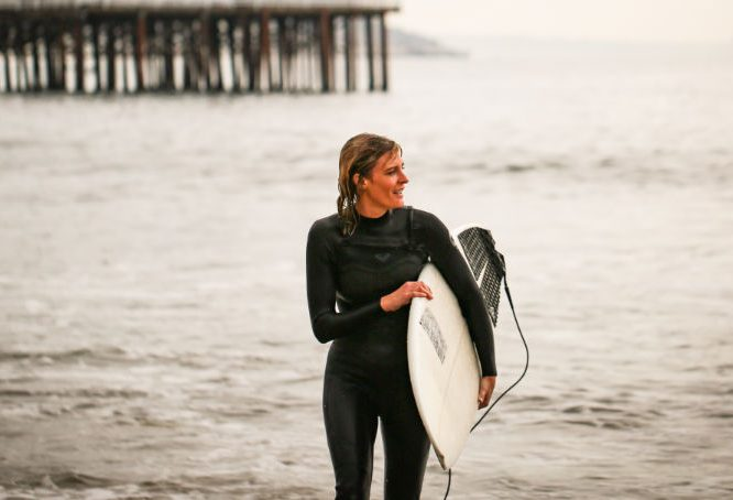 female surfer coming out of the water