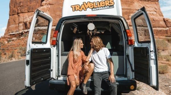 Sydney and Davis in back of Travel van