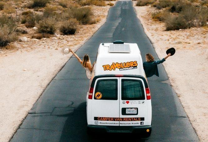 Sydney and Davis on the road in travel van