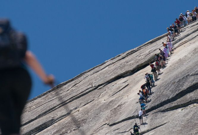 Hikers on Half Dome in Yosemite