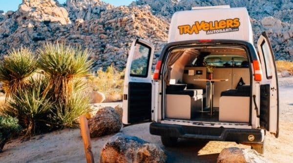 campervan with open rear doors at campsite