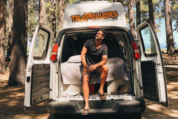 male sitting in campervan at Tahoe